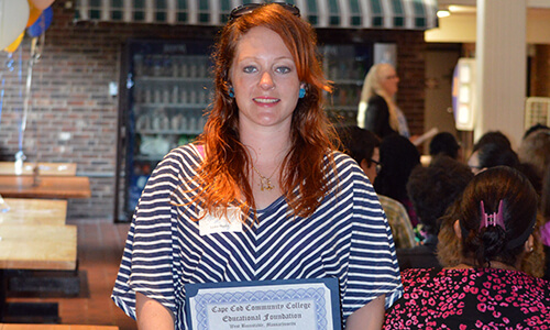 Student with scholarship award